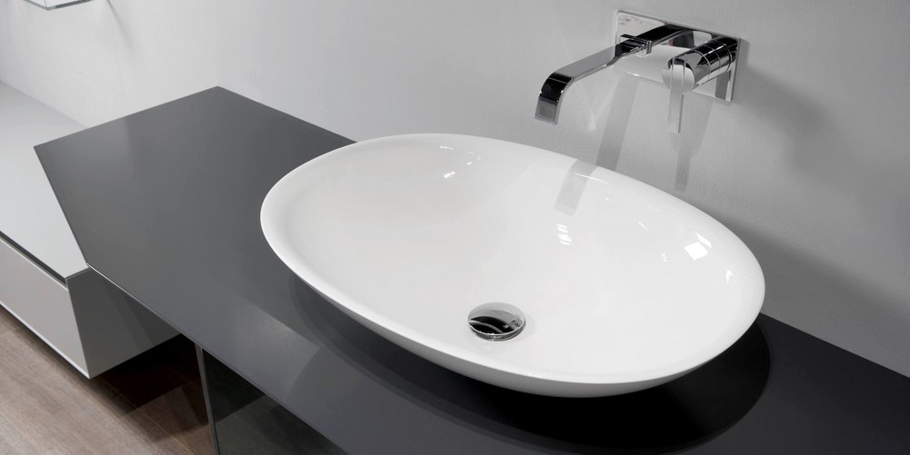 Servo Аntonio Lupi раковина овальная из материала Flumood или Ceramilux, встраиваемая в столешницу, в комплекте с донным клапаном и фитингом для сифона 63х45х15 см