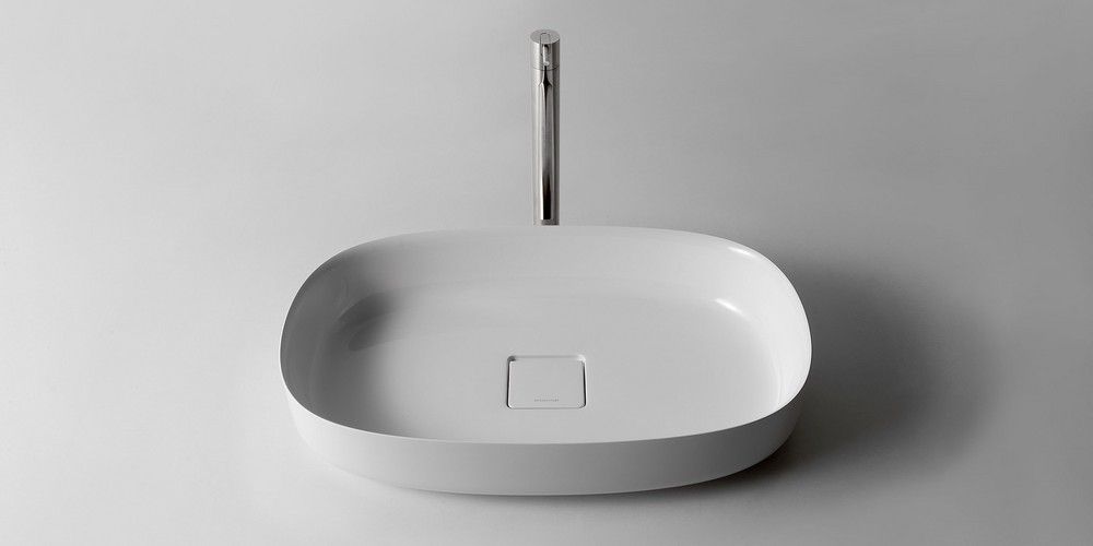 Bolo Аntonio Lupi раковина овальная из материала Flumood или Ceramilux, для установки на столешницу, в комплекте с донным клапаном и фитингом для сифона 63х40х12.5 см